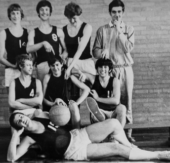 The school basketball team with me second row middle. That's the teacher with his finger up his nose!